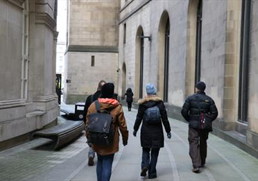 Daily Guided Walking Tour passing between Central Library and the Town Hall extension.