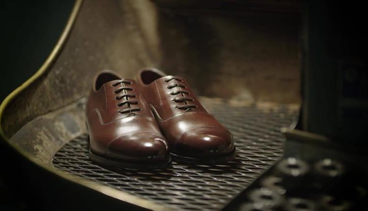 A pair of Loake shoes.