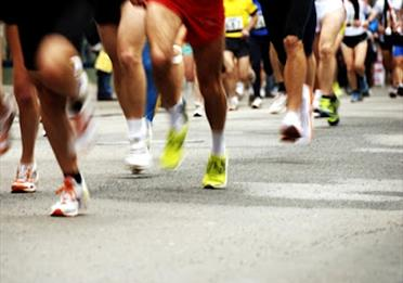 Picture of lots of running feet and legs taking part in a race