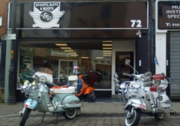 Scoots Suits and Boots shop front, scooters and shop