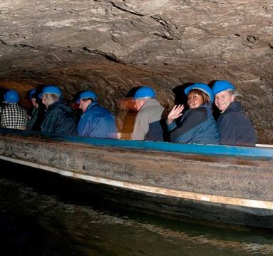 Boating along underground in Speedwell Cavern